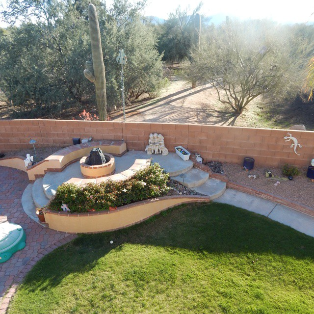 """For the newest #mommyreality challenge we are snapping pics of our """"view"""" Here's a pic of my desert encircled backyard where not pictured, just behind the wall also live snakes, lizards, turtles, frogs, coyotes and javelinas. Never a dull moment! Come share your view #mom at the link in my profile. Is it snowy, urban, rural? We want to see it @leapfrogandlipgloss"""
